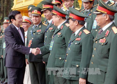 Chủ tịch nước Trương Tấn Sang tiếp Đoàn cán bộ cao cấp cựu chiến binh Quân đoàn 2. Ảnh: TTXVN.