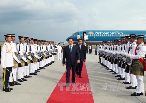 Quang cảnh lễ đón Thủ tướng Nguyễn Tấn Dũng tại sân bay quốc tế Kuala Lumpur. Ảnh: Đức Tám - TTXVN