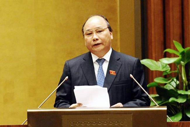 Phó Thủ tướng Nguyễn Xuân Phúc trả lời chất vấn của đại biểu Quốc hội (Ảnh: Ngọc Châu)