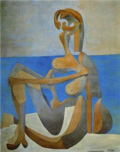 """Bức """"Người phụ nữ đi tắm biển ngồi trên bãi cát"""" (1929) khắc họa hình ảnh một người phụ nữ quái dị."""