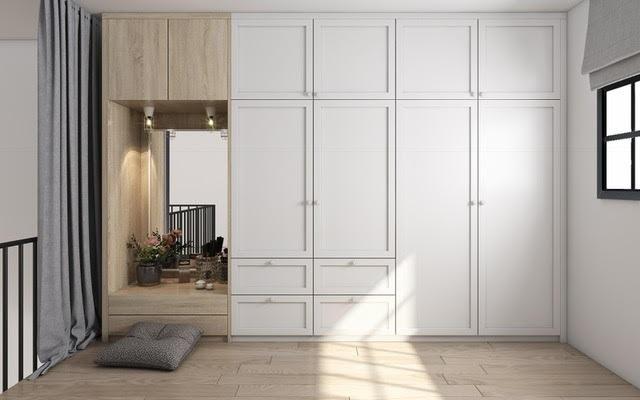 Không gian bàn trang điểm được bài trí thông minh giữa tủ âm tưởng và lan can của tầng lửng.