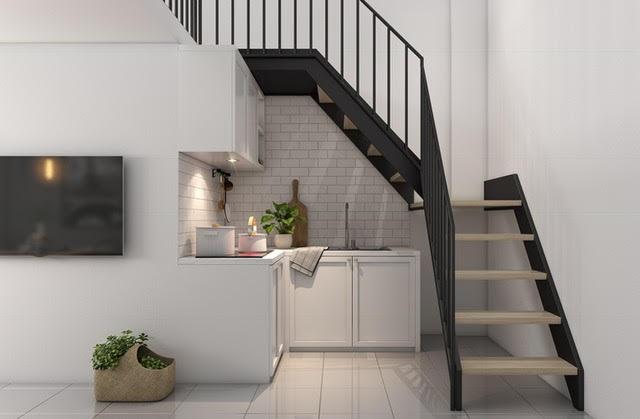 Không gian bếp xinh xắn nằm gọn dưới hầm cầu thang.