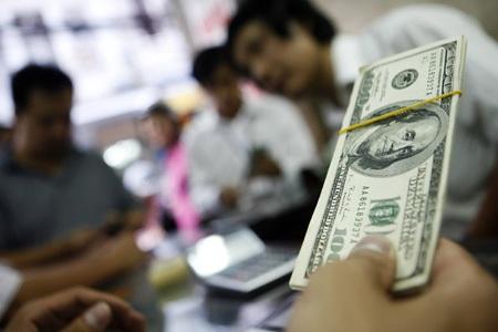 Chỉ trong vòng nửa năm, đồng USD đã tăng giá khoảng 20% so với đồng Yên Nhật và Đô-la Australia