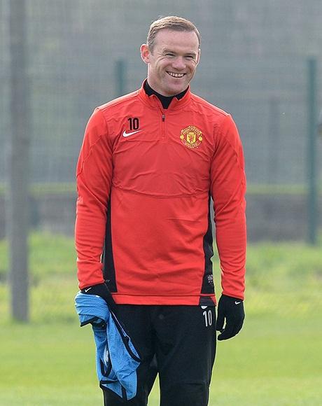 Rooney cười rạng rỡ. Dường như anh chẳng hề lo lắng khi phải thi đấu với Bayern Munich