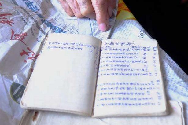 Cuốn sách từng được truyền thông Trung Quốc tuyên bố là có niên đại 600 năm, chứng minh chủ quyền của nước này với Biển Đông nhưng nay đã bị vứt đi. (Ảnh: China Daily)