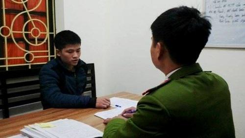 Cán bộ cơ quan CSĐT - CATP Hà Nội ghi lời khai của Nguyễn Công Ngọc
