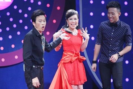 Các nghệ sĩ hài Hoài Linh, Việt Hương, Trấn Thành trong game show Người bí ẩn.
