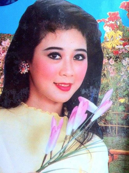 """Vẻ đẹp """"triệu người mê"""" của Nữ hoàng ảnh lịch Diễm Hương - 7"""