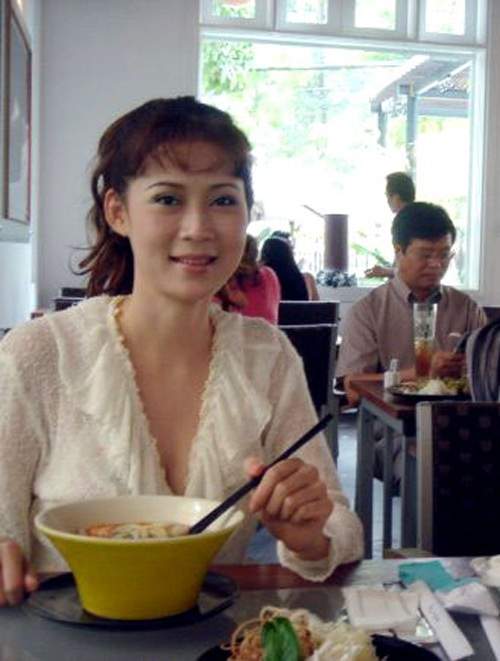 """Vẻ đẹp """"triệu người mê"""" của Nữ hoàng ảnh lịch Diễm Hương - 9"""