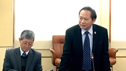 Thứ trưởng Trương Minh Tuấn (bên phải) phát biểu tại Hội nghị.