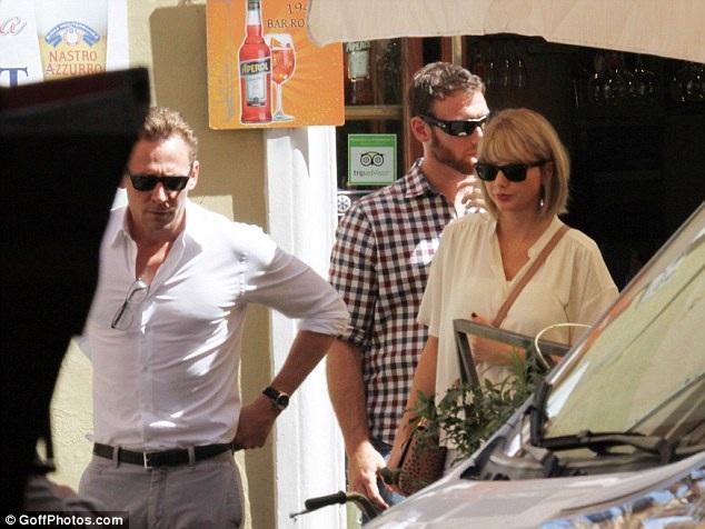Gu thời trang tình nhân tone-sur-tone của Taylor Swift và Tom Hiddleston - 2