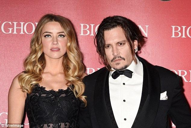 Amnber Heard và Johnny Depp thống nhất ly dị sau 15 tháng chung sống.