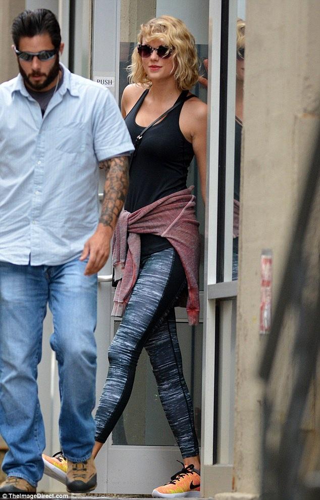 Taylor xuất hiện tươi tắn khi tới phòng tập gym ngày 6/9, sau khi thông tin cô và Tom chia tay được công bố.
