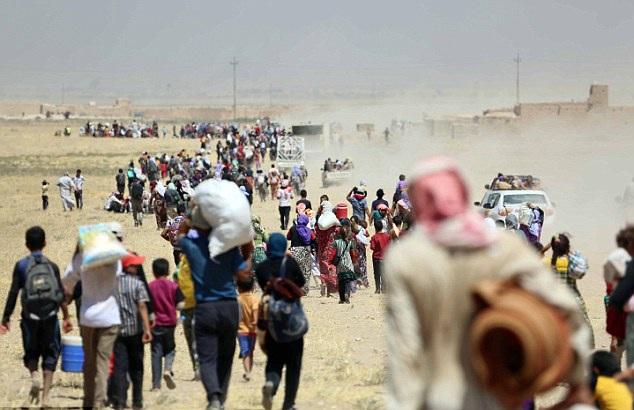 Hàng nghìn người Yazidi đã bị IS bắt cóc và sát hạt (Ảnh: Getty)