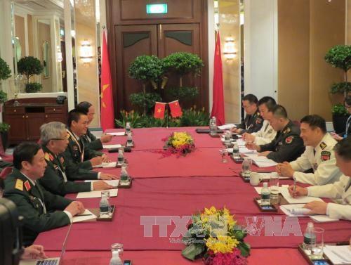 Thứ trưởng Bộ quốc phòng Nguyễn Chí Vịnh tiếp song phương Đô đốc Trung Quốc Tôn Kiến Quốc. Ảnh: Việt Dũng/TTXVN
