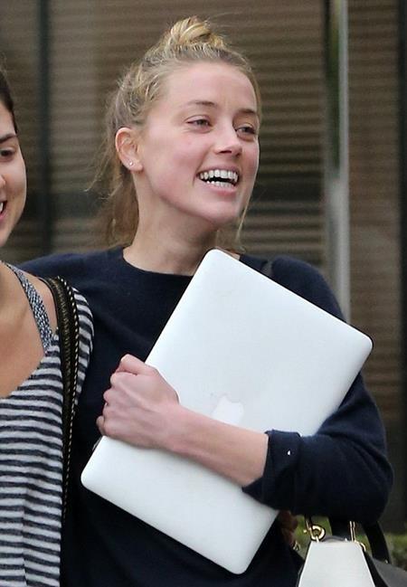 Amber Heard có thể mỉm cười mãn nguyện với quyết định ly dị