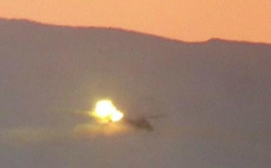 Trực thăng Mi-25 của Nga bị bắn rơi. (Ảnh: BBC)