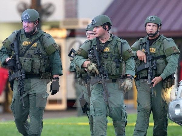 Cảnh sát Mỹ làm nhiệm vụ tại hiện trường một vụ nổ súng. (Nguồn: AFP/TTXVN)
