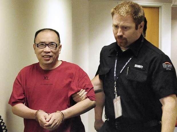 Nghi phạm Lai Changxing bị đưa về Trung Quốc năm 2011.