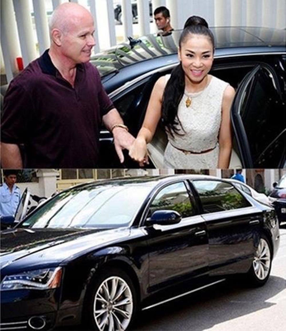 Vợ chồng Thu Minh cười bên... siêu xe
