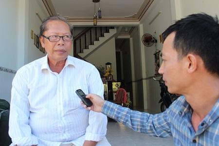 Ông Mai Thành Phúc trao đổi với phóng viên Dân trí - Ảnh: Việt Tùng