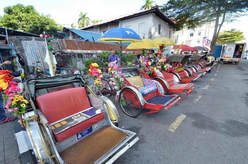 Xích lô đôi là phương tiện di chuyển rất được ưa chuộng tại Street art.