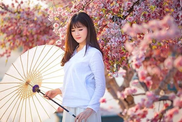 Hot girl Kiều Trinh đẹp như sương mai bên hoa anh đào - 9