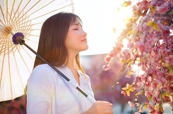 Hot girl Kiều Trinh đẹp như sương mai bên hoa anh đào - 8