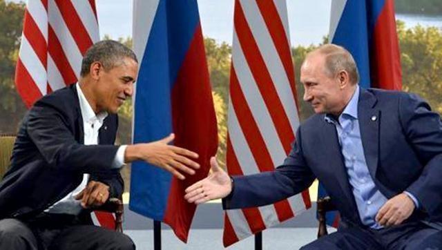 Tổng thống Nga Vladimir Putin (phải) và Tổng thống Mỹ Barack Obama (Ảnh: AFP)