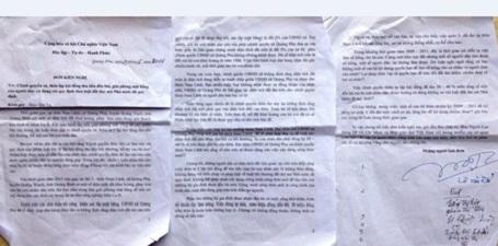Lá đơn kiến nghị về việc trả tiền đền bù không thỏa đáng của nhiều hộ dân thôn Nam Lãnh gửi đến báo Dân trí