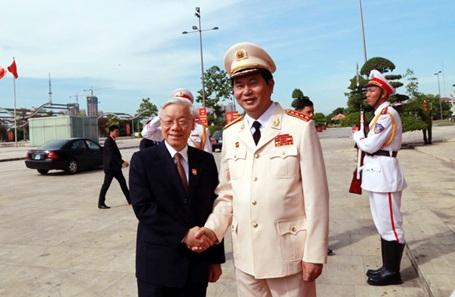 Bộ trưởng Trần Đại Quang đón Tổng Bí thư Nguyễn Phú Trọng tham dự buổi lễ Kỷ niệm trọng thể 70 năm Ngày truyền thống công an nhân dân - ngày 18/8/2015 (Ảnh: Công an Nhân dân)