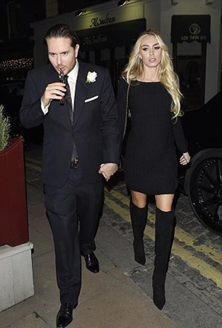 James cùng vợ đến tham dự cuộc từ thiện đấu giá