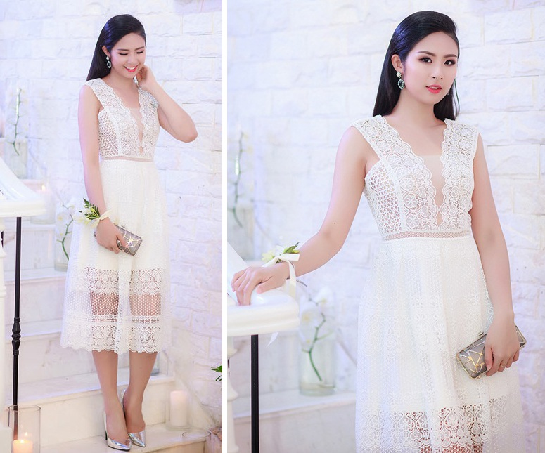 Hoa hậu Ngọc Hân diện thiết kế ren trắng nữ tính, kết hợp giày cao gót ánh bạc hài hòa. Cô thể hiện phong cách dịu dàng đầy quyến rũ.