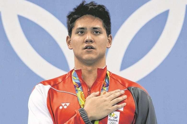 Schooling gây sửng sốt thế giới khi đánh bại siêu kình ngư Michael Phelps trên đường đua xanh