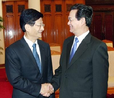 Thủ tướng Nguyễn Tấn Dũng và Bộ trưởng Bộ Công an Trung Quốc Mạnh Kiến Trụ - Ảnh: VGP/Nhật Bắc