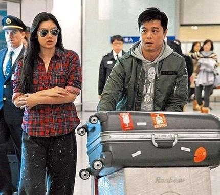 Lê Minh và vợ trẻ bịn rịn chia tay tại sân bay  - 7