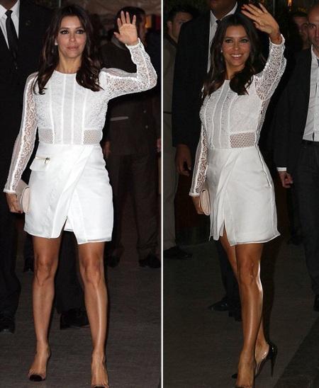 Sau đó, cô xuất hiện với bộ jumpsuit liền màu trắng thanh lịch