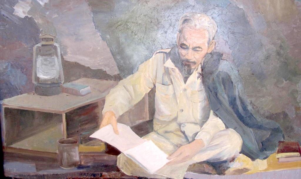 Bác Hồ đọc sách (Ảnh chất liệu sơn dầu).