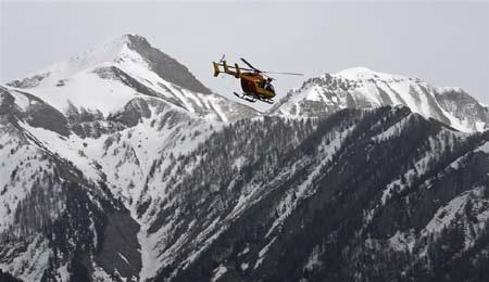 Vụ tai nạn xảy ra tại một vùng núi hiểm trở (Ảnh: AP)