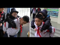 Trung Quốc: Cậu bé 12 tuổi 6 năm liền cõng bạn tới trường