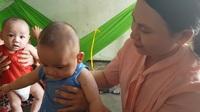 Bạn đọc báo Dân trí giúp đỡ thêm 40 triệu đồng cho 2 bé trai sinh đôi ở Nha Trang