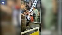 Hãi hùng cảnh người phụ nữ Trung Quốc mất chân vì kẹt vào thang cuốn
