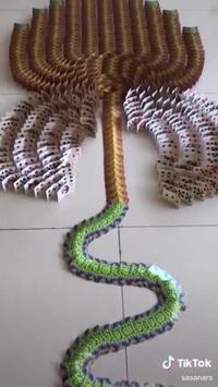 Ấn tượng với màn tạo hiệu ứng đổ domino từ những đồng xu và lá bài