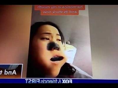 Quay clip câu view, cô bé kẹt nguyên chiếc kèn harmonica trong miệng