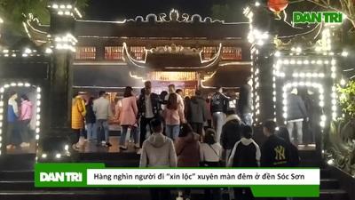 """Hàng nghìn người đi """"xin lộc"""" xuyên màn đêm ở đền thờ Thánh Gióng"""