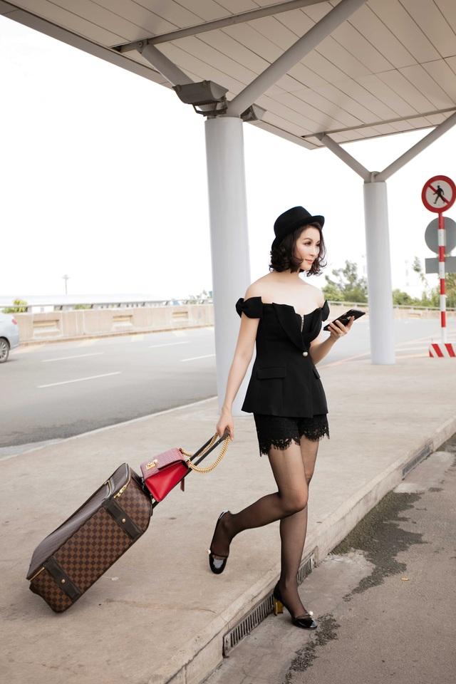 """Thanh Mai mặc """"mát mẻ"""" ra sân bay - 10"""