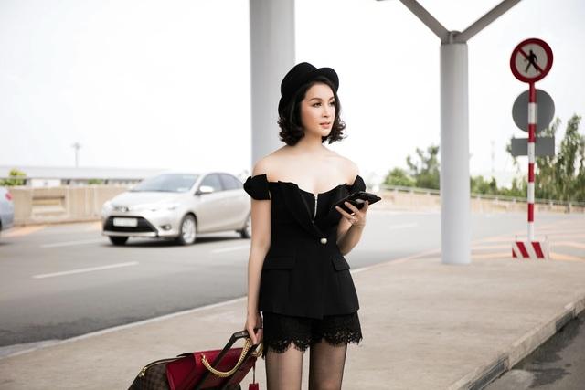 """Thanh Mai mặc """"mát mẻ"""" ra sân bay - 9"""