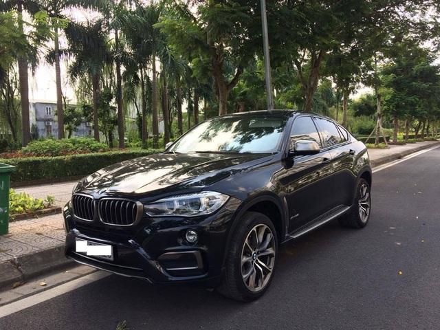 Một chiếc xe khá đăt tiền - BMW X6 có giá từ 3,389 tỷ tại Việt Nam của một chủ nhân trong khu nhà ở cho người nghèo