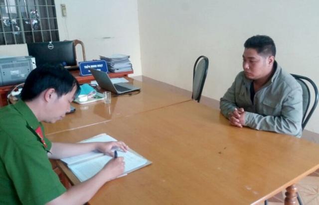 Trần Hoàng Vinh tại cơ quan công an (ảnh Đ. Huy)