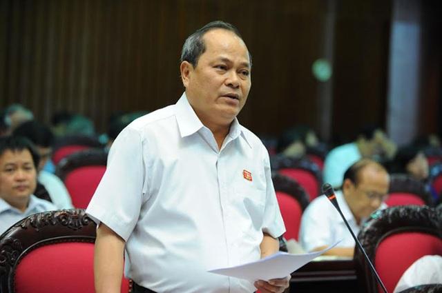 Cố Đại biểu Quốc hội Ngô Văn Minh trong một lần chất vấn thành viên Chính phủ